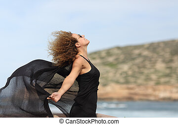 Happy woman enjoying holiday on the beach