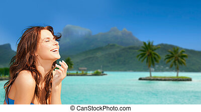 happy woman enjoying sun on bora bora beach
