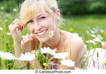 Happy woman enjoying the summer sunshine