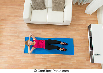 Happy Woman Exercising At Home