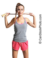 woman exercising with a jump rope
