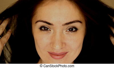 Happy Woman Face. Playful smile. Coquetry. Flirting. Close-up
