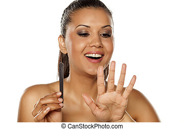 woman file her nails
