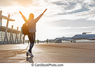 Happy woman flourishing arms at flying line