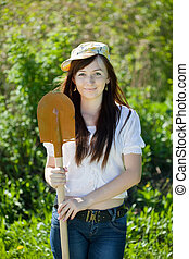 Happy  woman gardening with spade