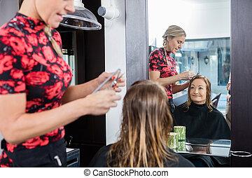 Happy Woman Getting Haircut In Beauty Salon