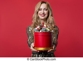 Happy woman giving box with present