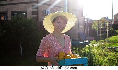 Happy Woman hands holding a crate with fresh ripe organic ...