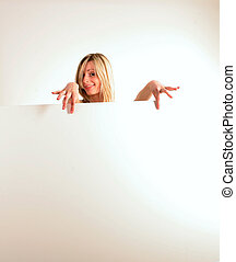 happy blondie woman holding white board