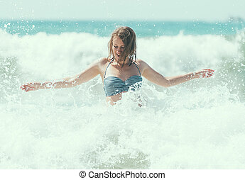 Happy woman having fun in the sea.