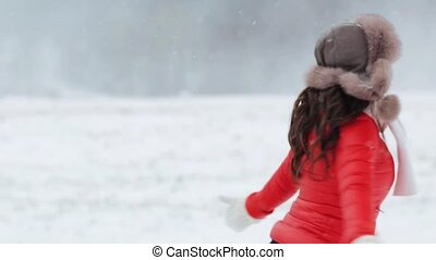 people, season, winter holidays and leisure concept - happy woman in fur hat having fun outdoors