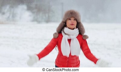 happy woman having fun outdoors in winter
