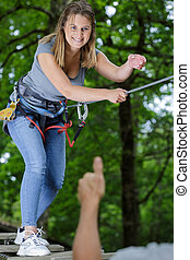 happy woman having great time in the adventure park