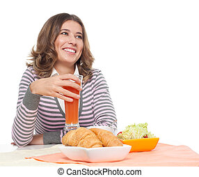 Happy woman having light breakfast