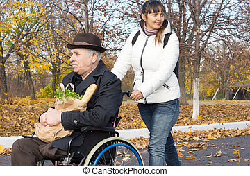 Happy woman helping a handicapped man