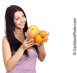 Happy woman holding a dish with fruits on white background