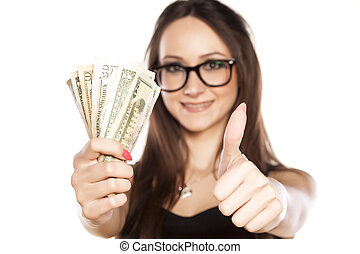 wad of money - happy woman holding a wad of money and...