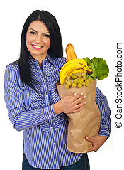 Happy woman holding bag with food