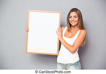 Happy woman holding blank board - Happy casual woman holding...