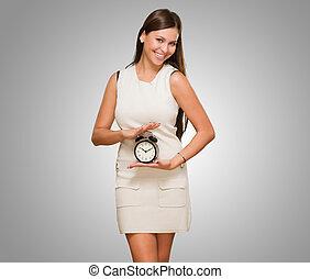 Happy Woman Holding Clock