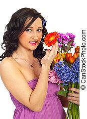 Happy woman holding flowers bouquet