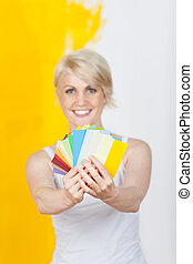 Happy Woman Holding Out Color Samples