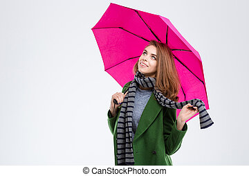 Happy woman holding pink umbrella