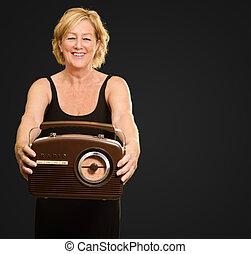 Happy Woman Holding Radio