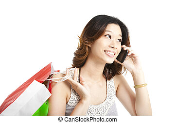 happy woman holding shopping bag and talking on the phone