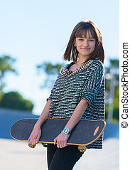 Happy Woman Holding Skateboard