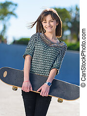 Happy Woman Holding Skateboard
