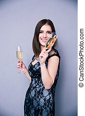 Happy woman holding two glass of champagne