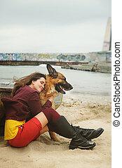 Happy woman hug her German shepherd dog,