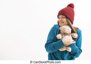 happy woman hugging a teddy bear
