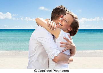 Happy Woman Hugging Her Husband