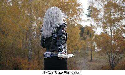 Happy woman in autumn park
