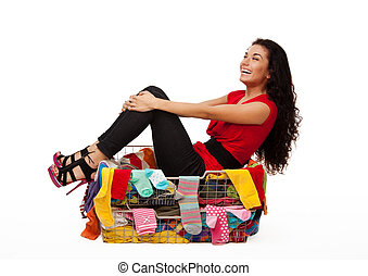 Happy woman in basket with clothes