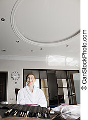 Happy woman in bathrobe