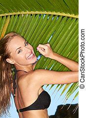 Happy Woman in Bikini Posing at Palm Leaves