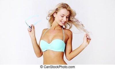 happy woman in bikini swimsuit with sunglasses - people,...