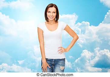 happy woman in blank white t-shirt over blue sky