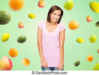 happy woman in blank white t-shirt over fruits