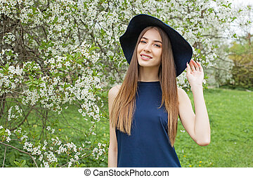 Happy woman in blue dress outdoor