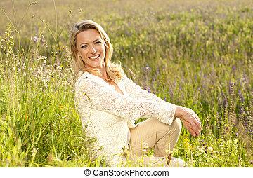 Happy woman in flower field