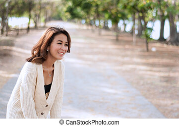 Happy woman in garden background