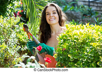 Happy woman  in gardening