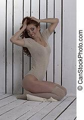 Happy woman in lingerie at studio