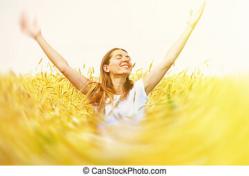 Happy woman in meadow.