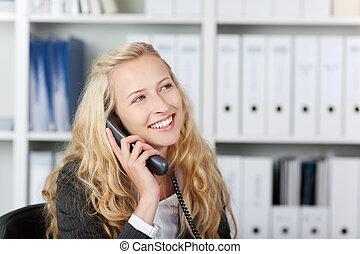 Happy Woman In Office Talking On Phone