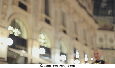 Happy woman in one of the world's oldest shopping malls, in...